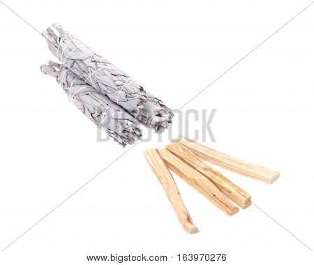 Sage and palo santo smudging sticks isolated on white background