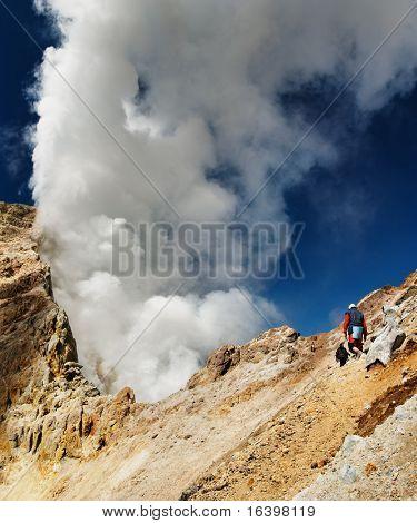 Climbing to active volcano