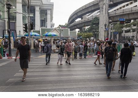 BANGKOK THAILAND - DEC 31 : unidentified tourist walk across crosswalk near Erawan shrine while new year Festival on december 31 2016 thailand. Erawan shrine is famous place in Ratchaprasong area