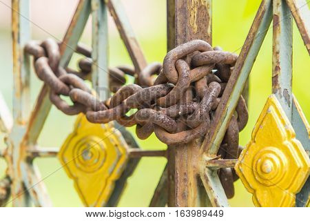 Chain lock the metal or iron gate.