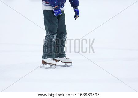 feet rolling on skates man on the ice rink