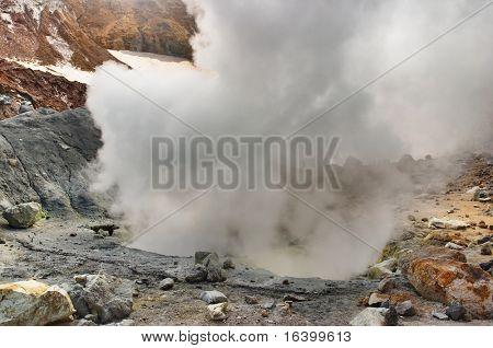 Sulfur fumarole in active volcanic crater.