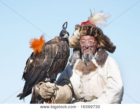 Old-man eaglehunter-berkutchi with golden eagle