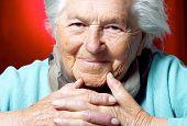 pic of elderly woman  - Elderly woman looking at camera head and shoulders view - JPG