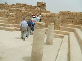 Tourists Leaving A Room In The Palace Of King Herod  poster