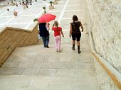 Tourists/Visitors/ Women And Girl Leaving /Walking Down Stairs poster