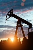 stock photo of oil well  - oil pump on sunset background - JPG