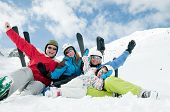 stock photo of family vacations  - Happy family ski team - JPG