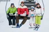 picture of family ski vacation  - Family on ski lift - JPG