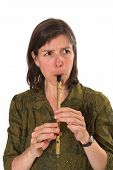 Mid-Age Woman Playing Flute