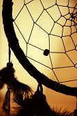 stock photo of dreamcatcher  - native american dream catcher in silhouette - JPG