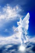 white angel over blue cloudy sky