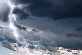 stock photo of lightning bolt  - lightning in dark cloudy sky - JPG