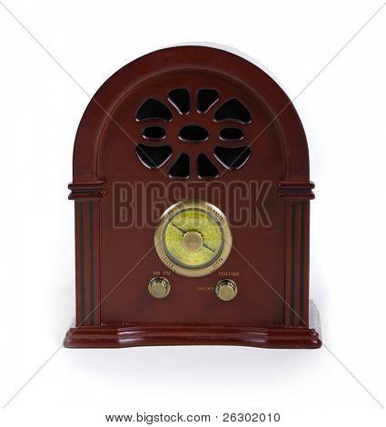 vintage wooden radio over white background