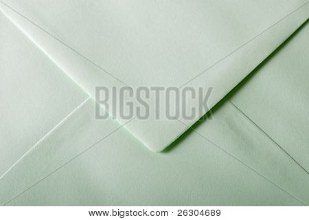 green envelope with textured paper