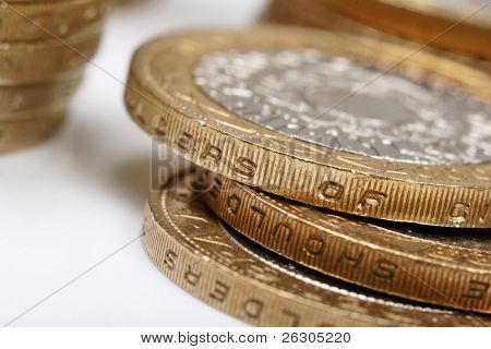 pile of £2 coins, uk currency