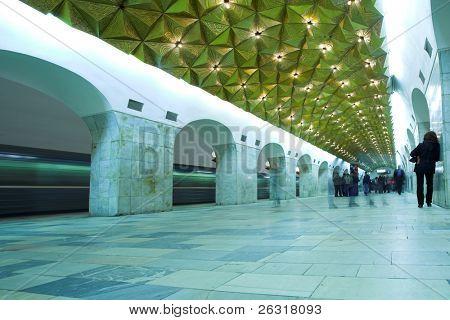 crowd waiting train on platform in subway