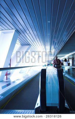 Move people on escalator in glass bridge