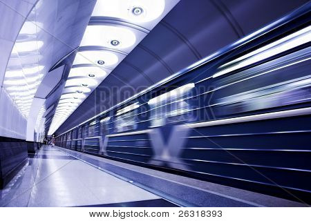 Blue train on platform in subway