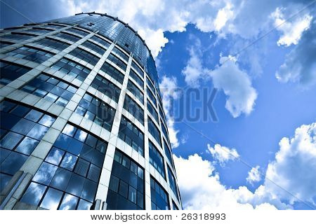 Blue modern office skyscraper on sky