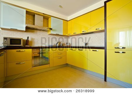 Yellow kitchen interior in modern flat