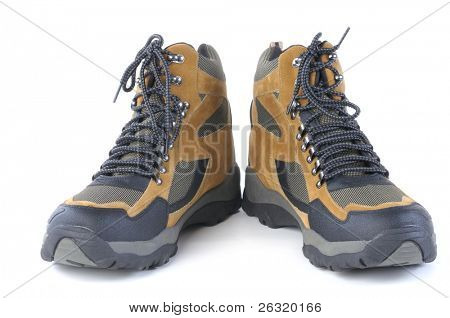 A pair of new hiking boots over a white background