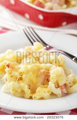 Macaroni and cheese with ham in the white plate