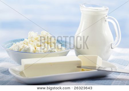 Butter, cottage cheese, and the jug of milk on the table