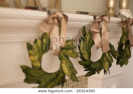 green wreath hanging on mantle