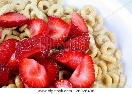 Cut up fresh strawberries on cereal with milk.