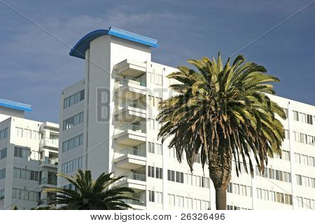 An apartment building or condo development in a tropical locale.
