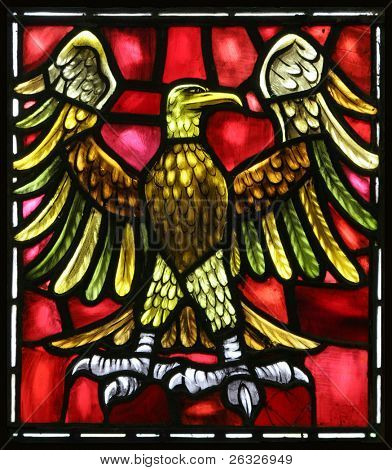 The eagle is the evangelical symbol of St. John.  From an old stained glass window in an Anglican Church in Bermuda.