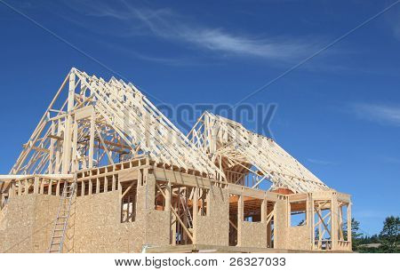 The frame of a new house under construction.