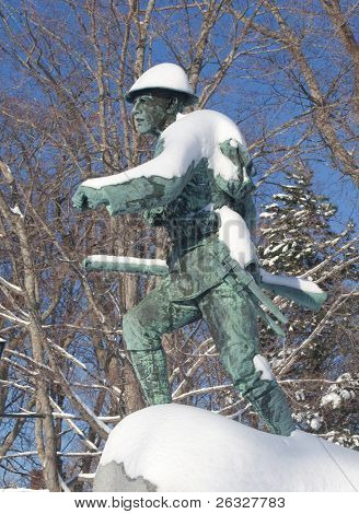 A public monument with a bronze WW1 soldier dedicated to those who fought in the two World Wars.  It stands in Memorial Square in the center of Summerside, Prince Edward Island.