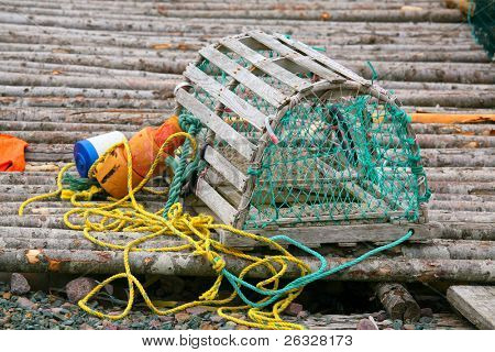 A wooden lobster trap with buoys and rope on Newfoundland, Canada.