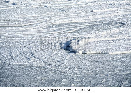 Sea ice swirling in the rough water of the Atlantic Ocean on the north shore of Prince Edward Island, Canada.