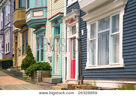 Traditional wooden row houses on the hilly streets of St. John's, Newfoundland, Canada