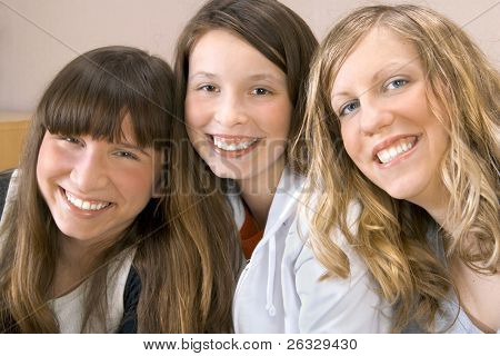 Happy three young women smiling.