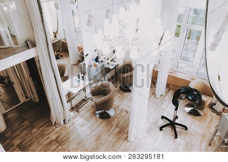 poster of Fashion Workplace. View From Above Beauty Salon. Fashion Salon. Luxury Design. White Interior In Spa