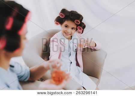 poster of Little Girl With Curlers. Beautiful Little Lady. Girl In Beauty Salon. Little Lady Front Mirror With