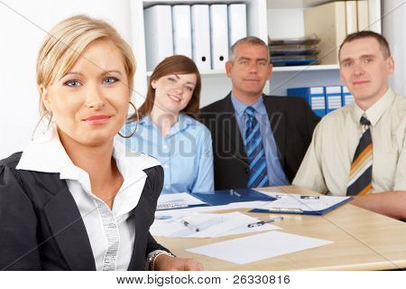 Business group at the meeting, beautiful woman in front