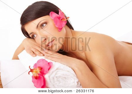 Attractive young woman relaxing in spa, beauty, wellness salon