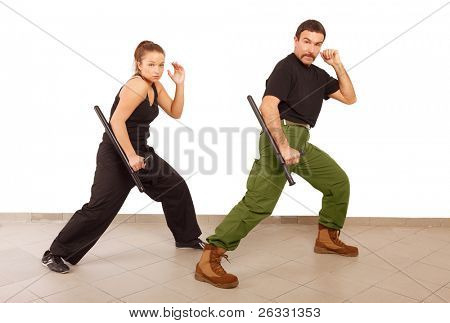 Man and woman practice fight with truncheon