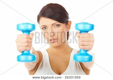 Portrait of fit young woman working with dumb-bells, isolated on white