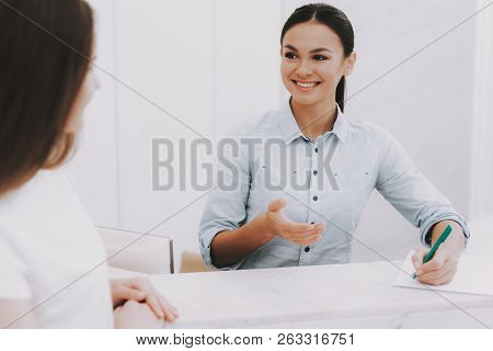 poster of Woman Receptionist. Reception Workplace. Workplace In Beauty Salon. White Interior. White Reception