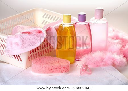 Baby care objects. Olive, shampoo, gel, towels, sponge and dummy