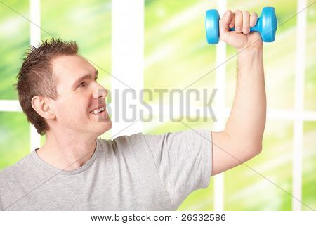 Portrait of happy man working with dumbbells