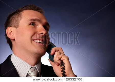 Portrait of smiling business man or politician with phone