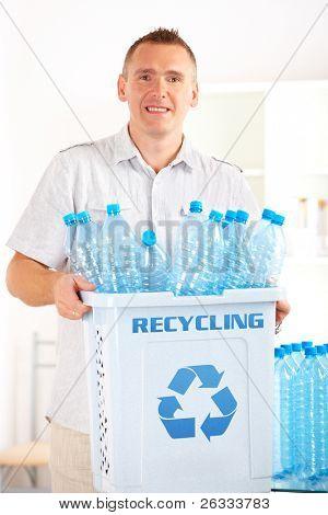 Happy man holding bin full of plastic blue bottles