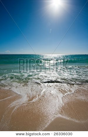 Beautiful beach, sun and waves of Caribbean Sea. Please search for other beach images in my portfolio - there are lots of them.